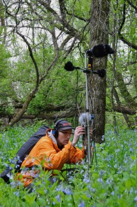 sound artist Paul Dickinson recording in woods